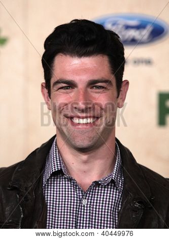 LOS ANGELES - AUG 12:  Max Greenfield arriving to FOX Fall Eco-Casino Party 2011  on August 12, 2011 in Culver City, CA