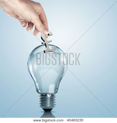 Hand and money inside an electric light bulb