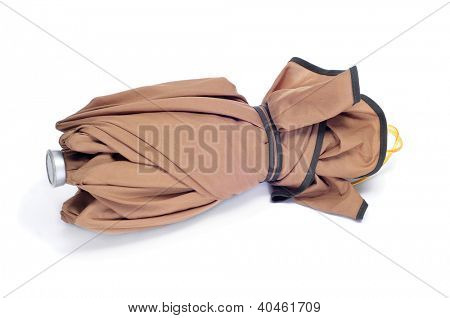 folded brown umbrella on a white background