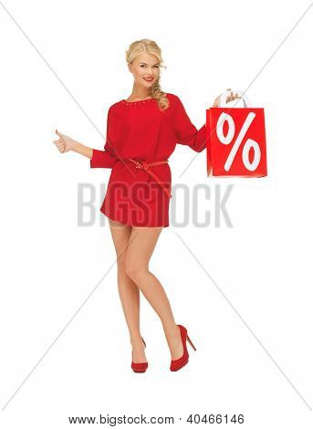 picture of woman in red dress with shopping bag showing thumbs up