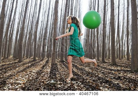Beautiful Blonde Girl, Dressed In Green, Jumping Into The Woods With A Balloon.