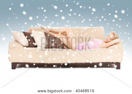 bright picture of sleeping woman on sofa with snow