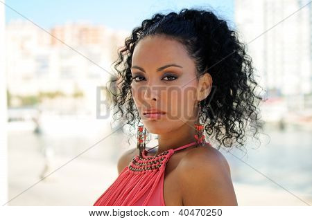 Young Black Woman, Model Of Fashion With Pink Dress And Earrings