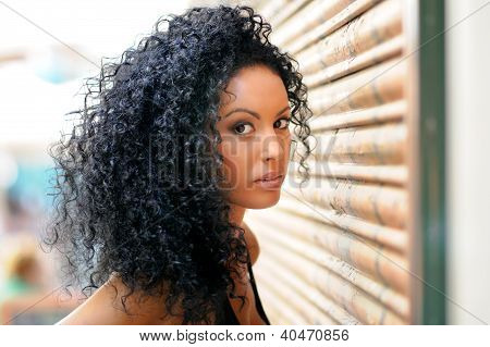 Young Black Woman In Urban Background