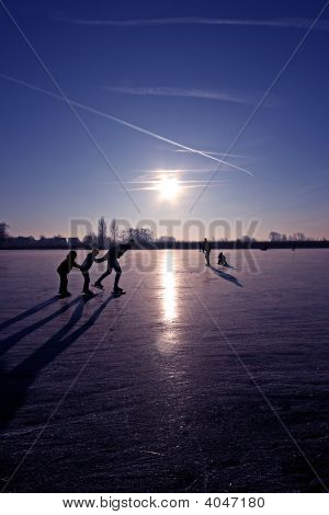 Typically dutch: ice skating on a frozen lake