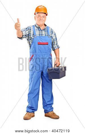 Full length portrait of a manual worker holding tool box and giving a thumb up isolated on white background