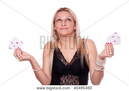 Beautiful blonde holding two aces in each hand - all aces in my hands concept, isolated on white