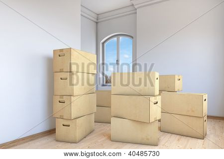 Many moving boxes in an empty apartment room
