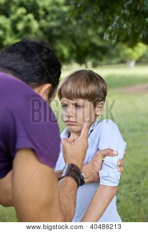 Parenthood And Children Education, Angry Man Scolding Boy In Park