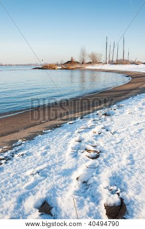 Curved River Bank In Winter