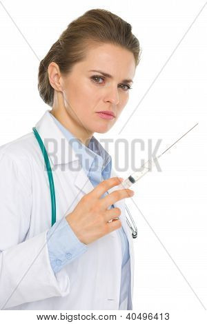 Serious Medical Doctor Woman With Syringe