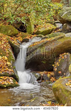 water cascading over rocks in the fall