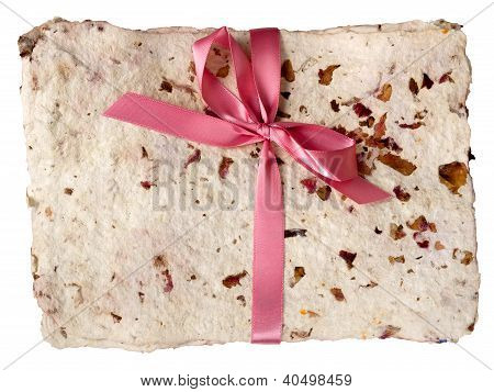 Handmade paper bundle, tied with ribbon
