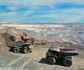 stock photo of iron ore  - Loading of iron ore on very big dump - JPG