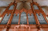 image of pipe organ  - Beautiful organ with a lot of pipes angle shot - JPG