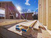 image of 2x4  - New house framing construction with studs and flooring being put up - JPG