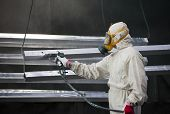 foto of air paint gun  - men at work painter painting metal designs with airbrush - JPG