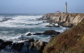 stock photo of mendocino  - Scenic Point Arena Lighthouse on the Pacific Ocean in Mendocino County Northern California USA - JPG