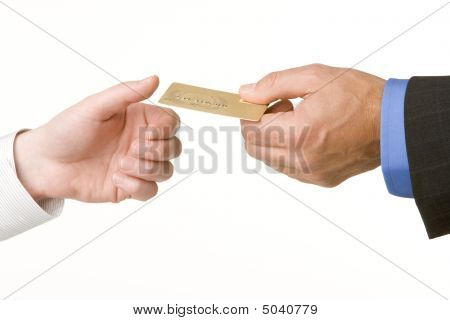 Businessmen Passing Another A Gold Credit Card