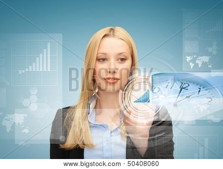 business, future technology and time management concept - businesswoman pointing at graph on virtual screen