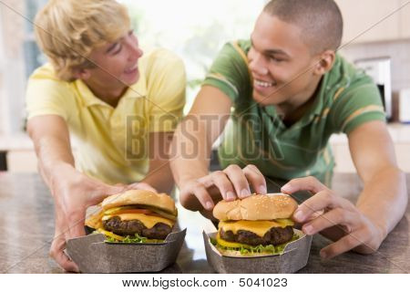 Teenage Boys Eating Burgers