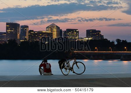 Cyclist silhouette and Rosslyn skyscrapers at sunset in Washington DC - United States