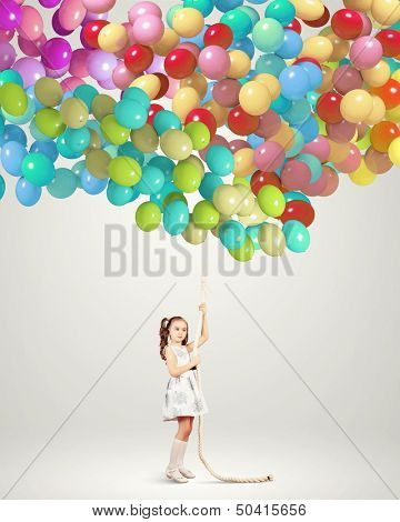 Image of little girl holding bunch of colorful balloons