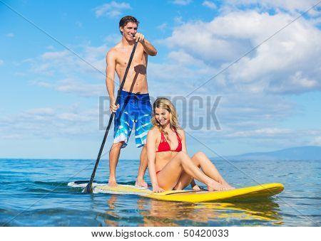 Attractive Couple Sharring Stand Up Paddle Board, Hawaii