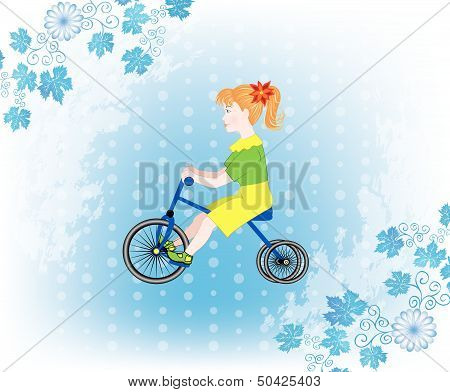 little girl on a tricycle