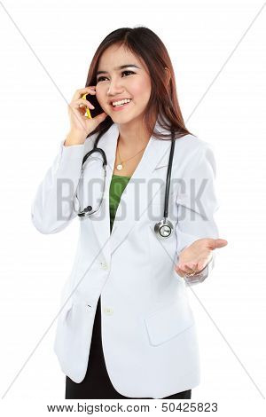 Attractive Female Doctor In Lab Coat With Stethoscope Talking With Cellphone