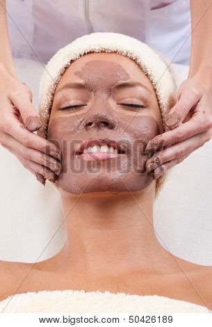 Woman getting a facial mask