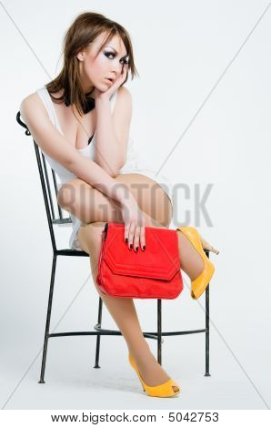 Beautiful Pin-up Girl With Red Bag
