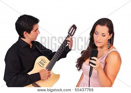 A Female Singer And A Male Guitarrist