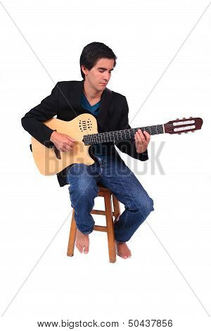 A Male Guitarrist In Action