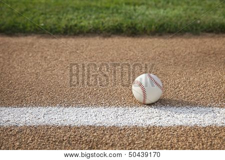 Baseball On Base Path With Grass Infield