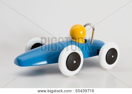 Blue Race Car With Yellow Driver Isolated With Discreet Shadow