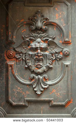 Monstrous Face Carved In A Door