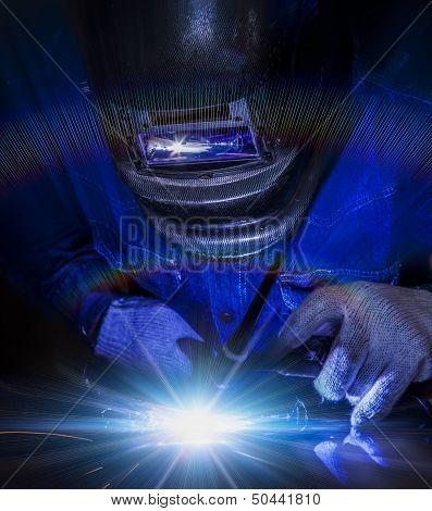 Worker Welding The Steel Part