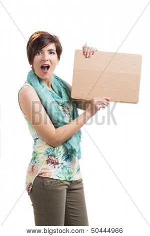 Beautiful woman holding a cardboard and admired with something on it, isolated over a white background