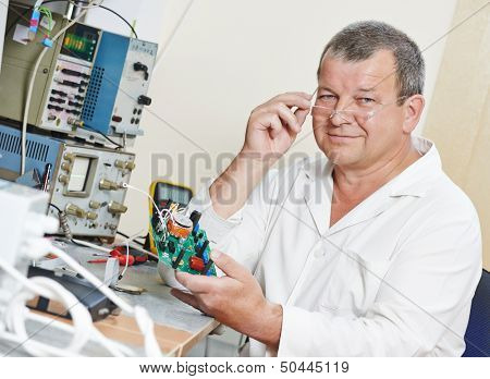 male technicial engineer scientist with microchip plate at test laboratory factory