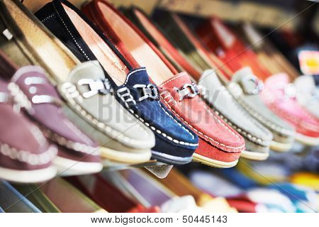Row of slip-on shoes in a footwear shop
