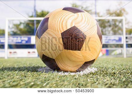 Wooden football on penalty spot