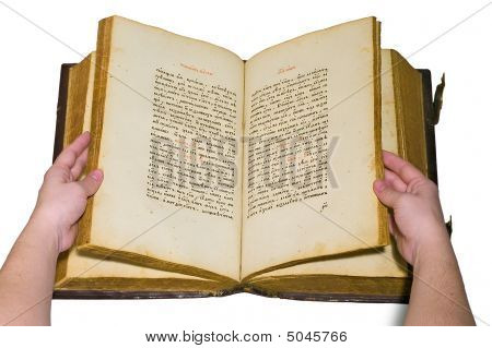 Arms Are Turn Over The Pages Of Opened Old Book