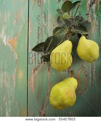 Yellow Pears On Wooden Rusty Surface