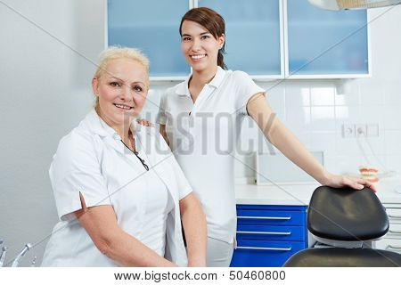 Portrait of female dentist and dental assistant in their dental practice