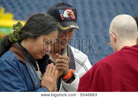 Buddhist Monk Blesses And Prays With The Faithful
