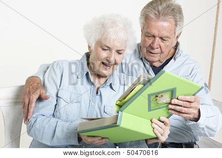 Senior couple looks at picture album