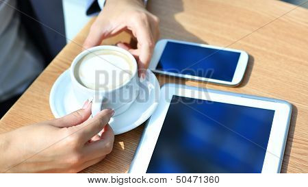 Businessman using digital tablet computer with modern mobile phone