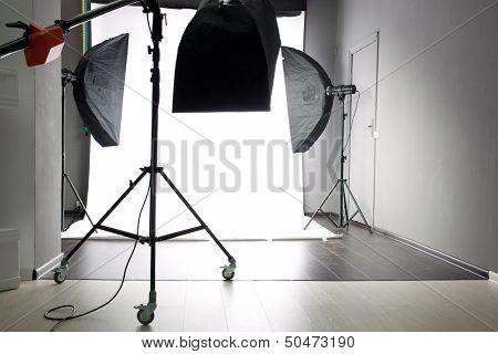 interior of modern photo studio with lighting equipment
