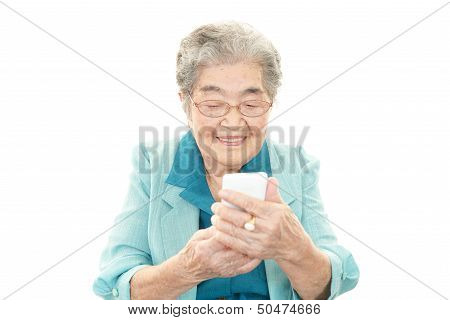 Smiling old woman with mobile phone